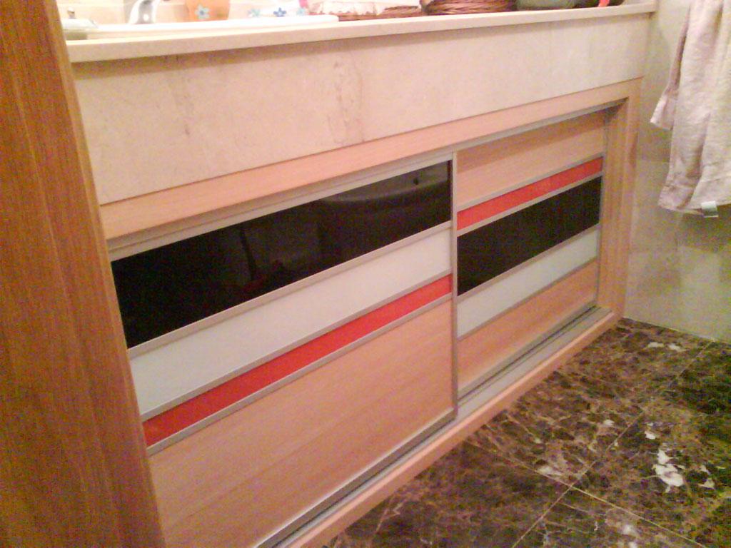 mueble bajo encimera haya negro blanco y naranja